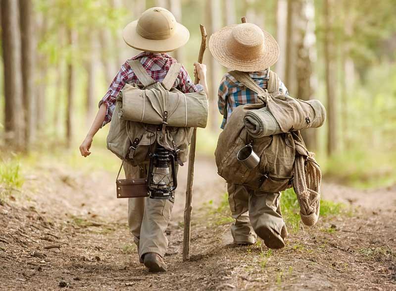 Two boys walking path